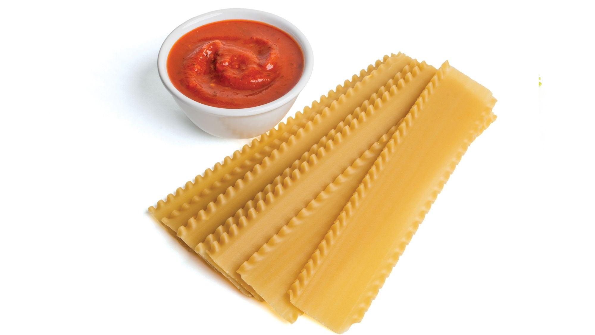 Lasagna ingredients - brown rice noodles and marinara sauce
